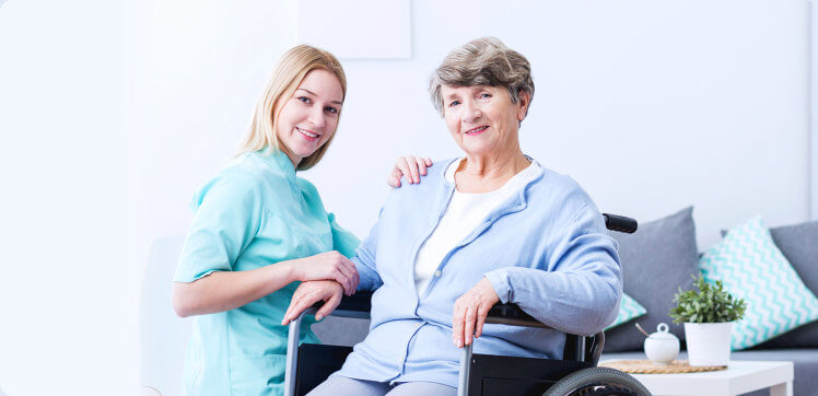 elder woman and caregiver smiling